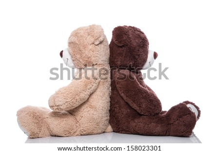 Teddy bears back to back isolated on white background - stock photo