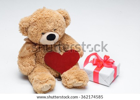 Teddy Bears couple with red heart. Valentines Day concept.