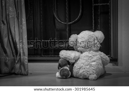 Teddy bears in a deep depression, black&white, concept - stock photo