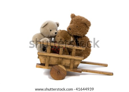 Teddy Bears In Wheelbarrow - stock photo