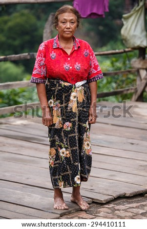 TEDIM, MYANMAR - JUNE 17 2015: Local lady in the hill village of Tedim in recently opened to tourists Chin State, Myanmar (Burma). - stock photo