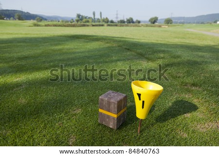 tee box and fairway of a beautiful golf course - stock photo