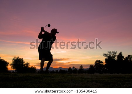 Teeing Off at Sunrise - stock photo