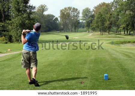 Teeing off into the fairway - stock photo