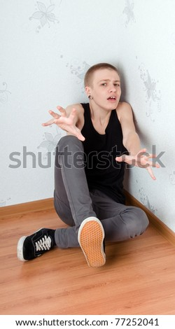 Teen afraid to sit in the corner - stock photo