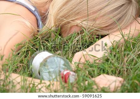 Teen alcohol addiction (drunk teen with vodka bottle) - stock photo