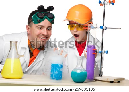 Teen and teacher of chemistry at chemistry lesson making experiments isolated on white background - stock photo