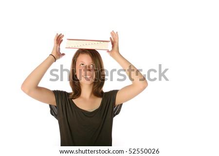 Teen balancing book on her head - stock photo