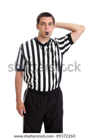 Teen basketball referee giving sign for offensive foul - stock photo