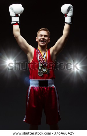Teen boxer with many medals - stock photo