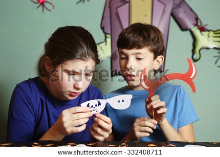 teen boy and girl make decoration to halloween party - stock photo