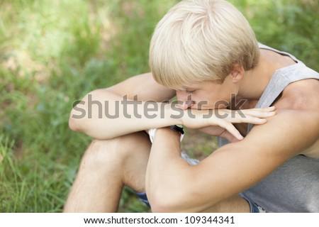 Teen boy at green park. - stock photo