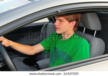 Teen boy behind the wheel of a car