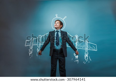 Teen boy businessman superhero pilot wings from the aircraft infographics shows the growth dynamics in the business photo - stock photo