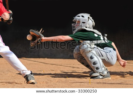 Teen boy catching a baseball game - stock photo