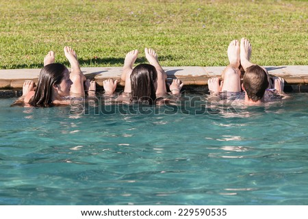 Teen Boy Girls Swim Pool Hangout Teenagers girls boy swim pool hangout summers day home talk laugh playtime - stock photo