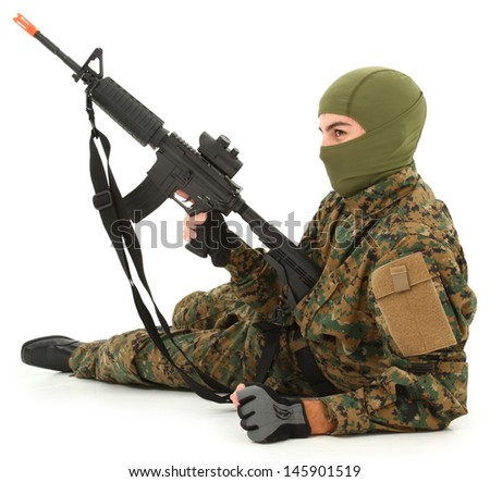 Teen boy in camo gear with air rifle. - stock photo