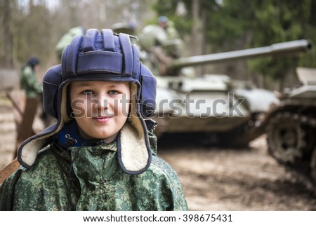Teen boy in tank helmet