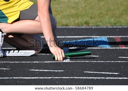 Teen Boy in the Starting Blocks at a Track Meet