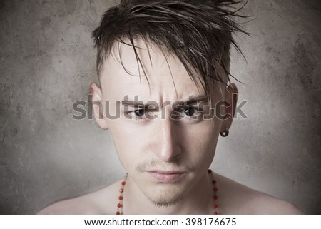 Teen boy looking aggressive - stock photo