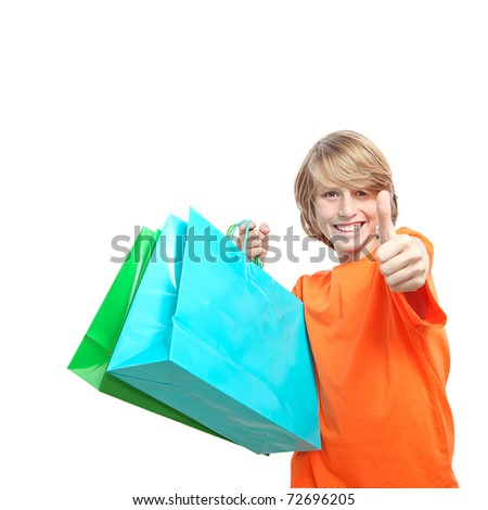 teen boy or kid shopping with shopping bag - stock photo