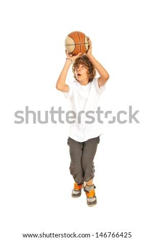 Teen boy playing basketball isolated on white background - stock photo