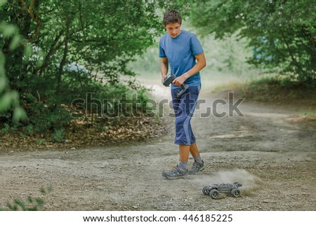 Teen boy playing radio control car