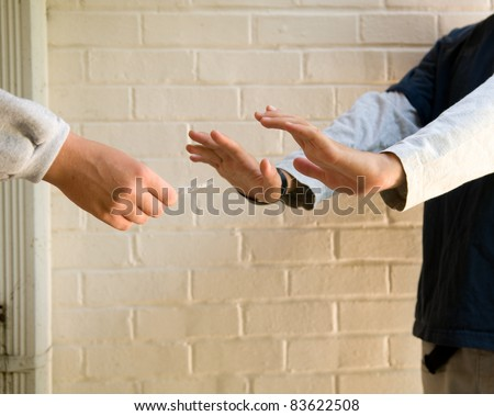 teen boy refusing marijuana cigarette from another boy - stock photo