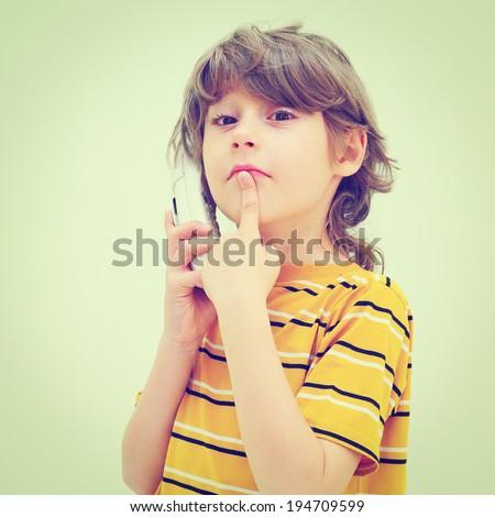 Teen Boy Relax By Talking on Wireless Telephone, Retro Effect - stock photo