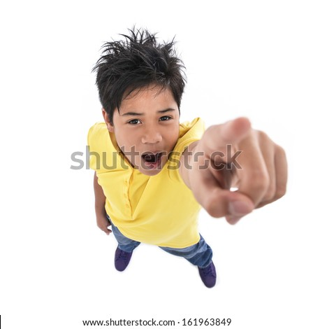 Teen boy shows his finger gently on the white background - stock photo