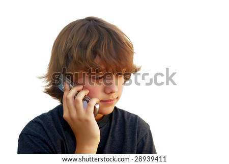 Teen boy talking on mobile phone isolated on white background. - stock photo