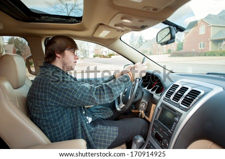 teen boy texting and driving - stock photo