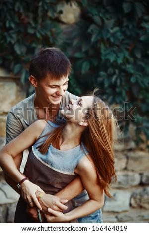 Teen couple bonding, having fun. - stock photo