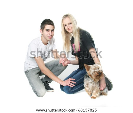 teen couple with yorkshire terrier over white - stock photo