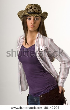Teen cowgirl in tank top and Hat with long dark hair - stock photo