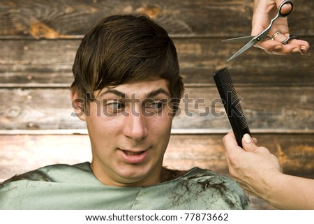 teen during cutting hair portrait - stock photo