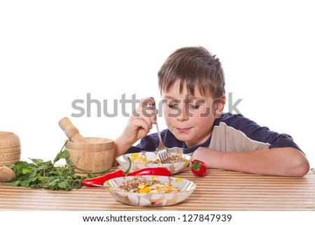 Teen eats healthy food on a white background - stock photo