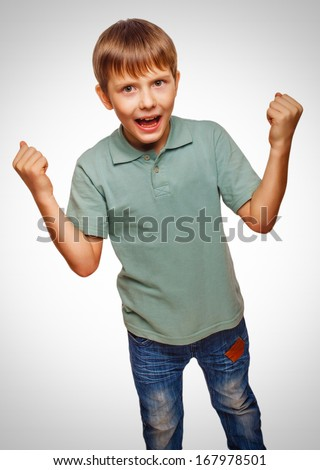 teen excited happy teenage boy shows his hand so his fists emotions isolated on white background gray - stock photo