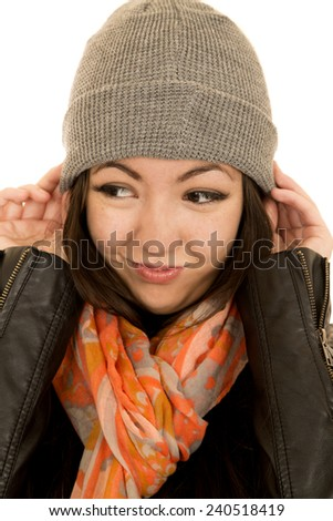 Teen female model wearing beanie looking away - stock photo