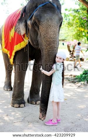 Teen girl and  elephant calf on Orchid island Vietnam - stock photo