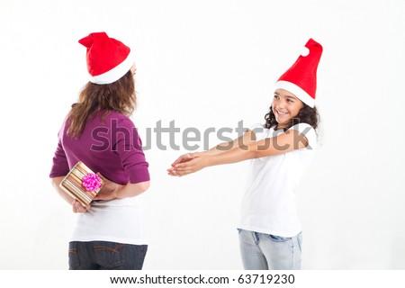 teen girl asking mother for christmas gift - stock photo