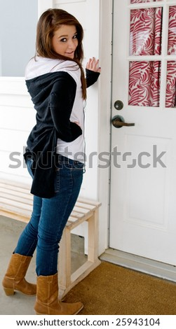 Teen girl at the door of her cottage - stock photo