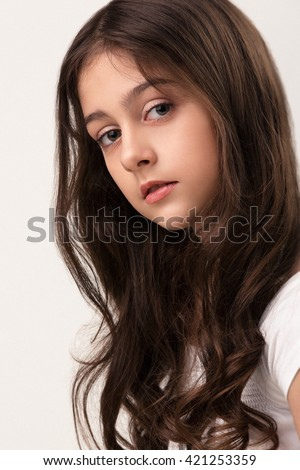 teen girl cheerful enjoying beauty portrait with beautiful bright brown long hair isolated on white background - stock photo