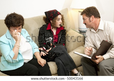 Teen girl complains to the therapist as her mother cries.  (designs on bandana and jacket are generic and not part of a trademark or copyright) - stock photo
