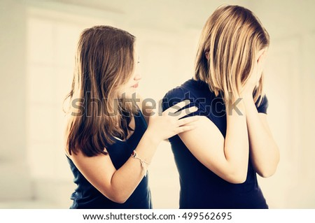 Teen girl consoling her sad friend. Teenager problem concept