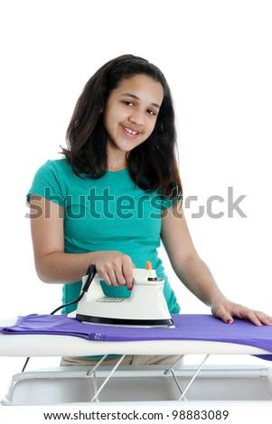 Teen Girl Doing Her Chore of Ironing - stock photo