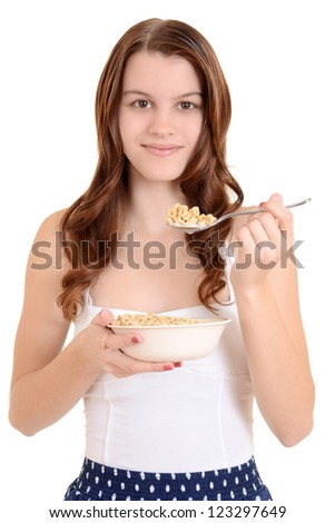 Teen girl eating cereal - stock photo