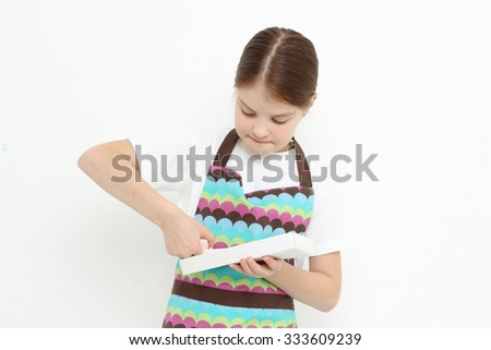 Teen girl eating sweet paste - stock photo