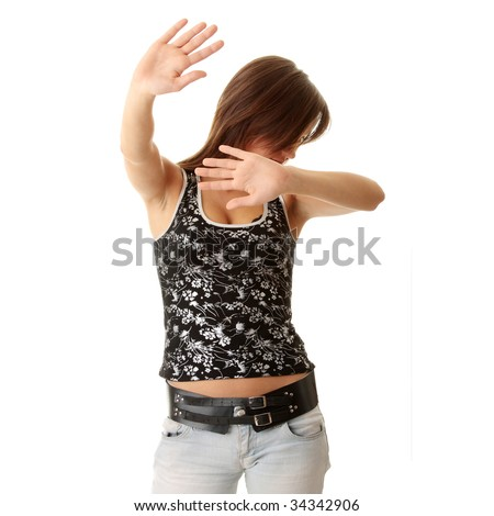 Teen girl frighten, covering her face - abuse crime concept - stock photo