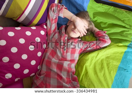 Teen girl frustration crying lying on the bed - stock photo